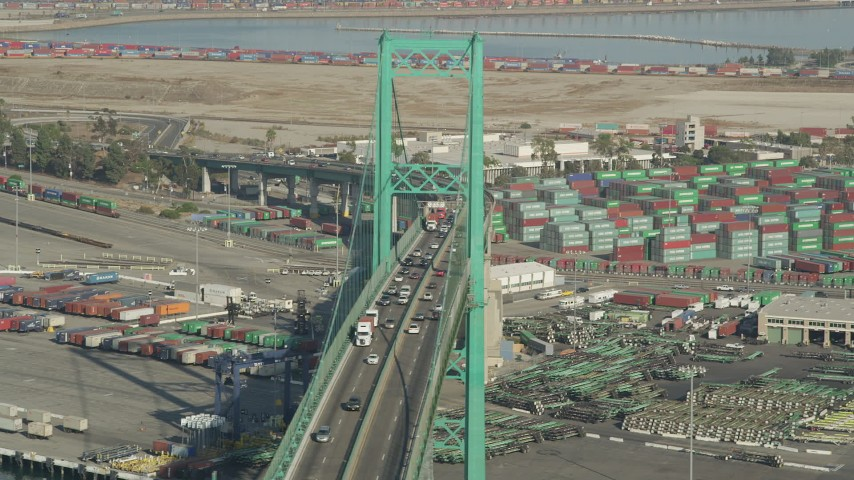 5K stock footage aerial video of traffic on the Vincent Thomas Bridge near Port of Los Angeles shipping containers, California Aerial Stock Footage | AX68_152