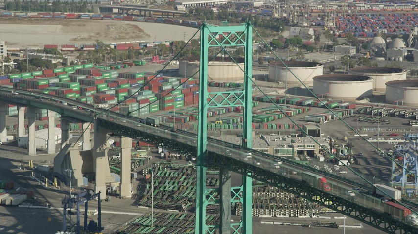 Vincent Thomas Bridge and light traffic at the Port of Los Angeles, California Aerial Stock Footage | AX68_153