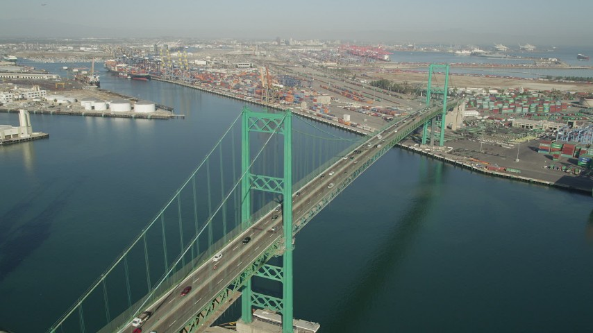 5K stock footage aerial video approach the Vincent Thomas Bridge at the Port of Los Angeles, California and tilt to traffic Aerial Stock Footage | AX68_156