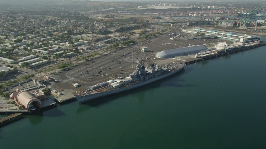 5K stock footage aerial video reverse view of the USS Iowa and the Port of Los Angeles, California Aerial Stock Footage | AX68_160