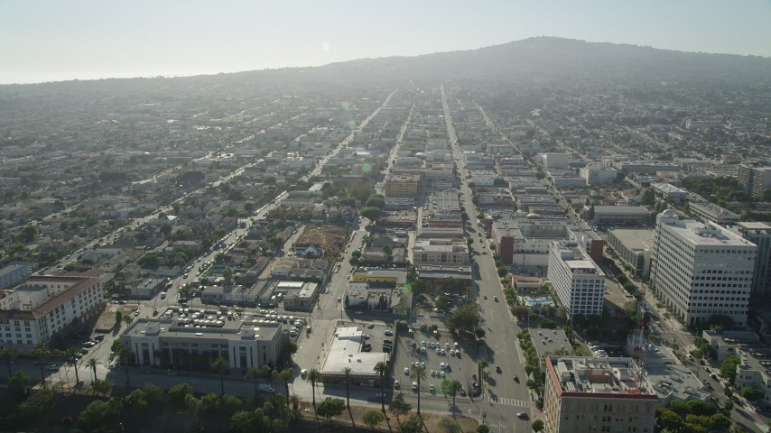 City streets with low-rise office and apartment buildings in San Pedro, California Aerial Stock Footage | AX68_161