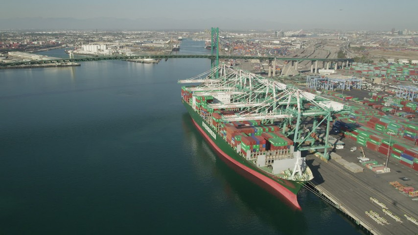 5K stock footage aerial video flyby docked cargo ship to approach Vincent Thomas Bridge at Port of Los Angeles, California Aerial Stock Footage | AX68_163