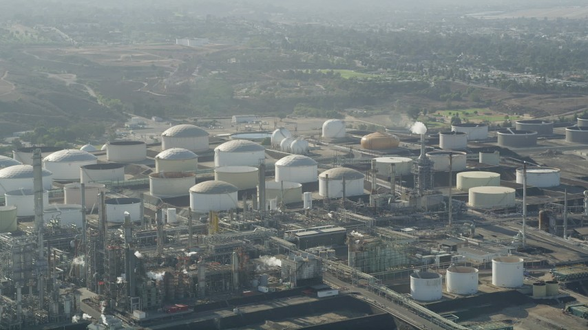 Passing tanks at the Los Angeles Refinery Wilmington Plant in San Pedro, California Aerial Stock Footage | AX68_172