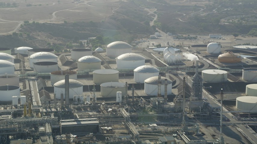 Flyby tanks at the Los Angeles Refinery Wilmington Plant in San Pedro, California Aerial Stock Footage | AX68_173