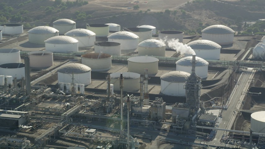 5K stock footage aerial video flyby tanks at the Los Angeles Refinery Wilmington Plant in San Pedro, California Aerial Stock Footage | AX68_173