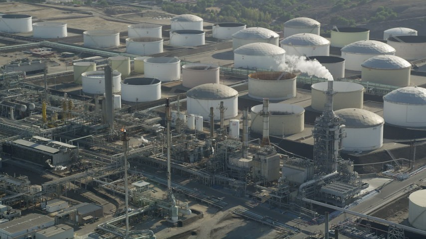 Large tanks at Los Angeles Refinery Wilmington Plant in San Pedro, California Aerial Stock Footage | AX68_174