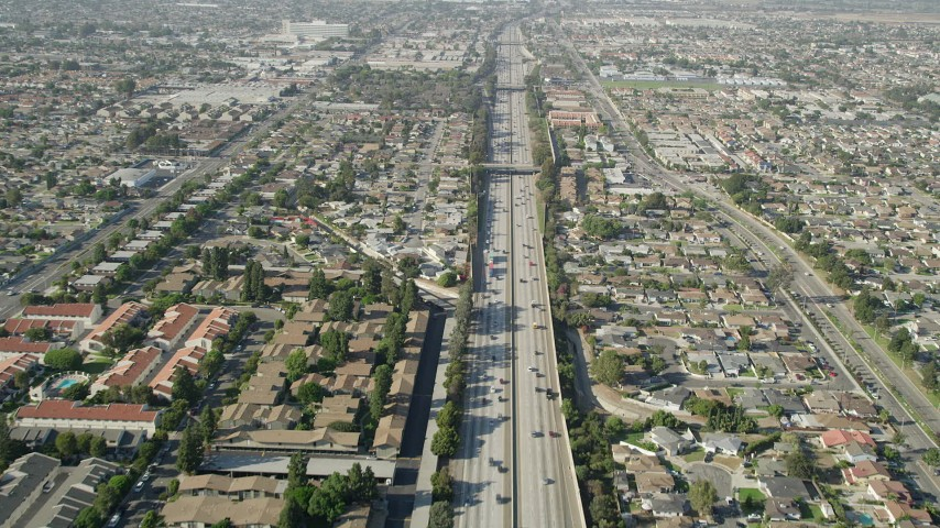 5K stock footage aerial video fly over light traffic on I-110 through suburbs in Carson, California Aerial Stock Footage | AX68_176