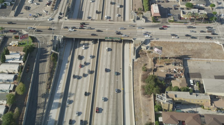 5K stock footage aerial video bird's eye view of cars traveling on Interstate 110 through Carson, California Aerial Stock Footage | AX68_178
