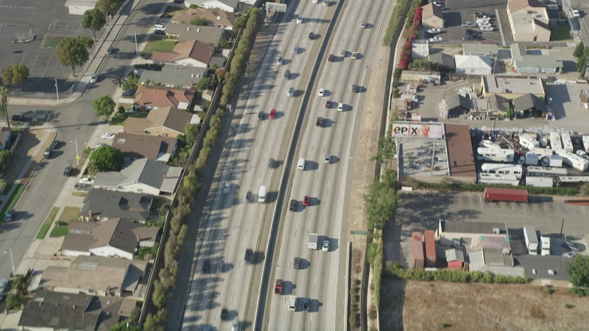 5K stock footage aerial video of a bird's eye view of light traffic on a bend in I-110 in Carson, California Aerial Stock Footage | AX68_179