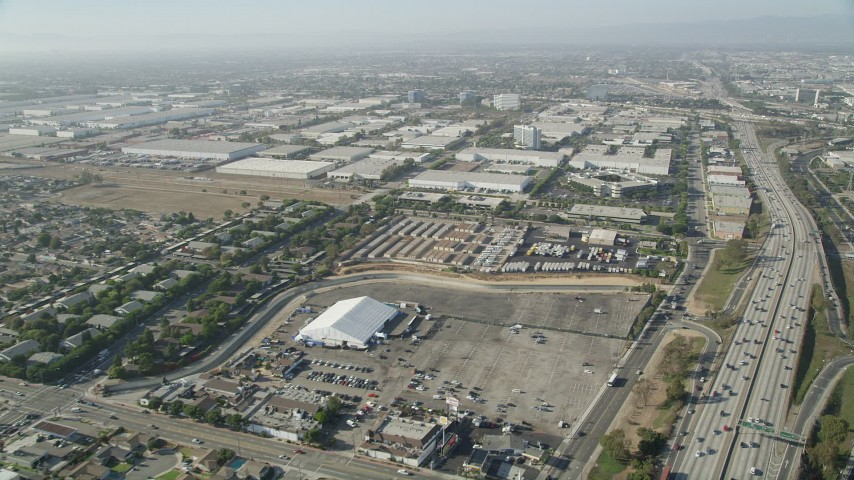 5K stock footage aerial video approach office and warehouse buildings by I-110 in Torrance, California Aerial Stock Footage | AX68_180