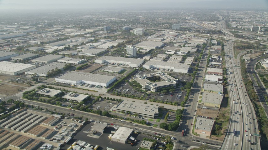 5K stock footage aerial video of office buildings and several warehouses by I-110 in Torrance, California Aerial Stock Footage | AX68_181