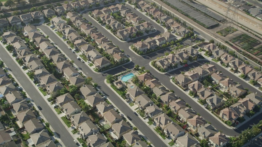 5K stock footage aerial video tilt to a bird's eye view of tract homes in Gardena, California Aerial Stock Footage AX68_185 | Axiom Images