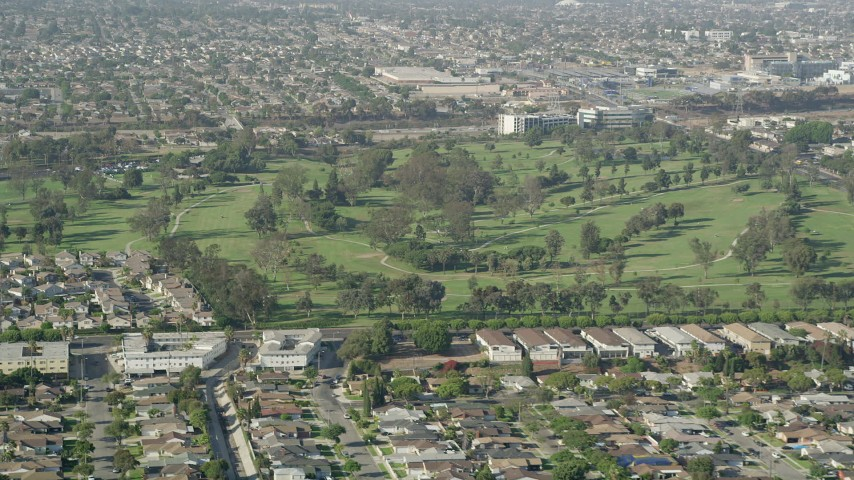 5K stock footage aerial video of Chester Washington Golf Course in Hawthorne, California Aerial Stock Footage | AX68_189