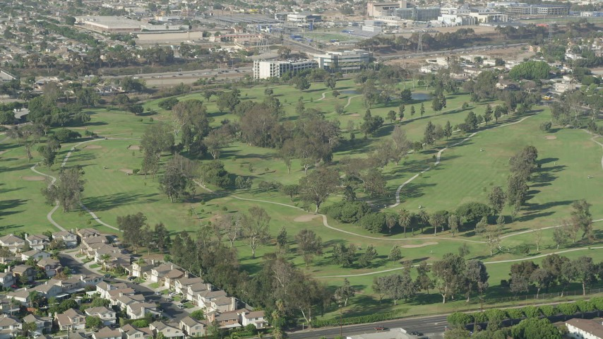 5K stock footage aerial video of golfers and carts at Chester Washington Golf Course in Hawthorne, California Aerial Stock Footage | AX68_190