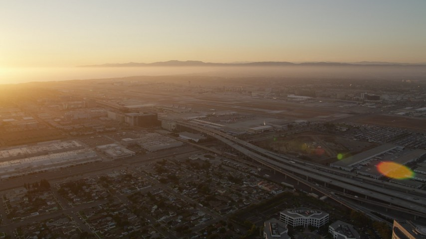 5K stock footage aerial video of sunset at Los Angeles International Airport in California Aerial Stock Footage | AX69_002