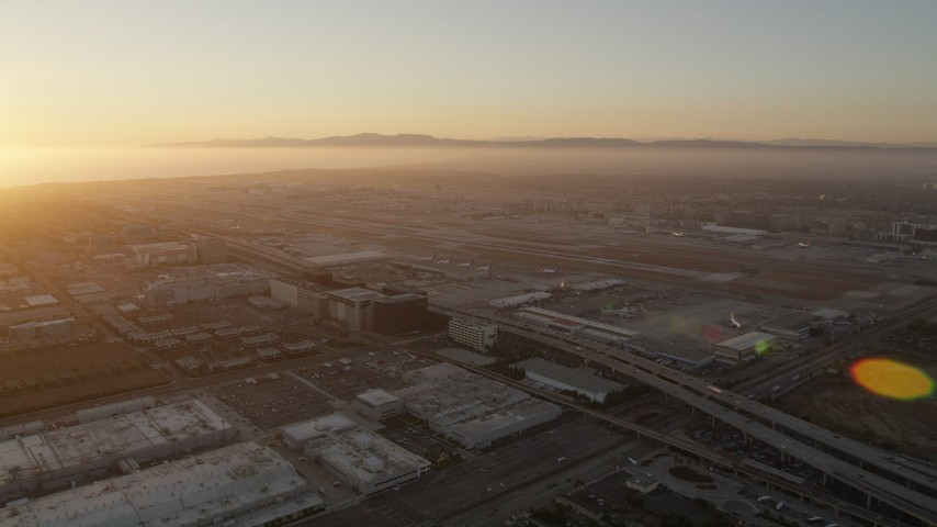 5K stock footage aerial video of sunset at the Los Angeles International Airport in California Aerial Stock Footage | AX69_003