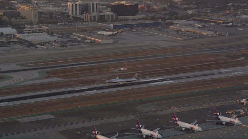 5K stock footage aerial video track American Airlines passenger jet landing at LAX at sunset, Los Angeles, California Aerial Stock Footage | AX69_011