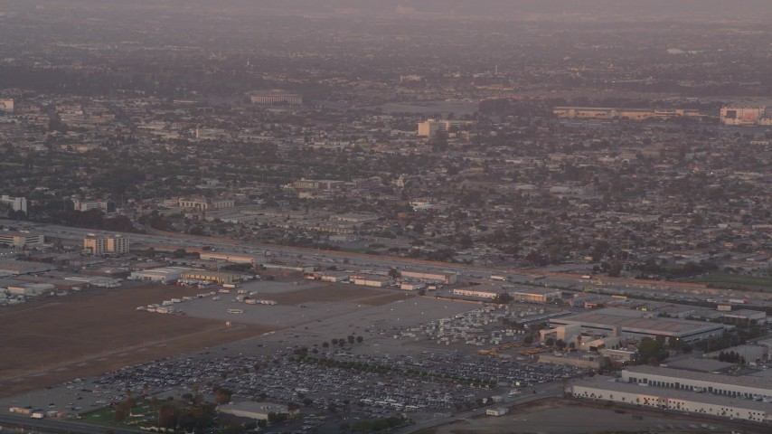 5K stock footage aerial video of tracking an airliner approaching LAX at sunset for a landing, Los Angeles, California Aerial Stock Footage | AX69_013