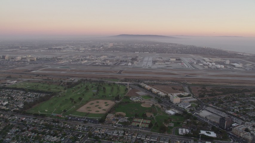 5K stock footage aerial video pan across Los Angeles International Airport at sunset in California Aerial Stock Footage | AX69_018