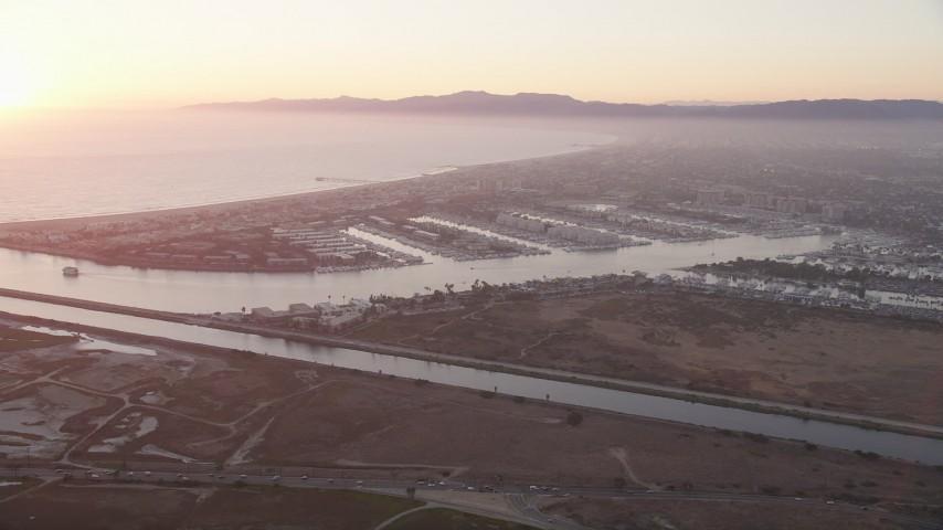 5K stock footage aerial video of sunset at Marina Del Rey coastal neighborhoods, California Aerial Stock Footage | AX69_019