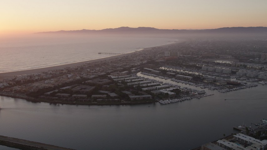 5K stock footage aerial video approach apartment buildings and neighborhoods in Marina Del Rey, California, at sunset Aerial Stock Footage | AX69_021
