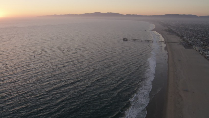Approach Venice Fishing Pier on the California Coast at sunset Aerial Stock Footage | AX69_023