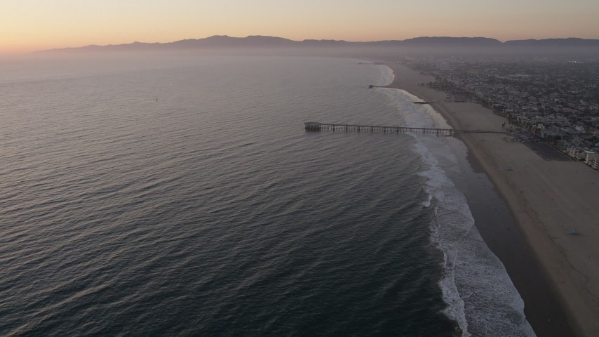5K stock footage video approach Venice Fishing Pier on the California Coast at sunset Aerial Stock Footage | AX69_023