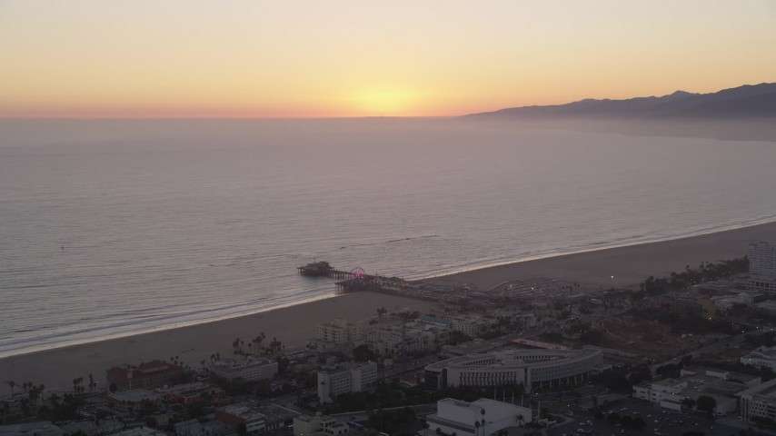 5K stock footage aerial video approach Santa Monica Pier at sunset, California Aerial Stock Footage | AX69_031