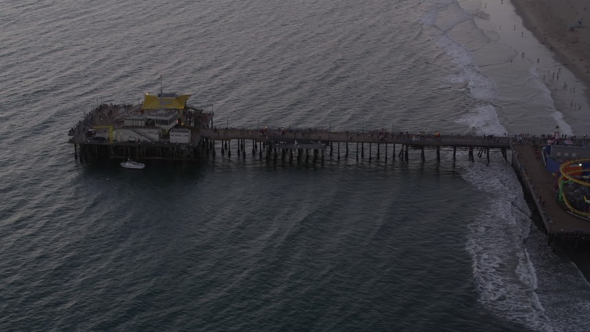 Flyby end of Santa Monica Pier at twilight, California Aerial Stock Footage | AX69_034