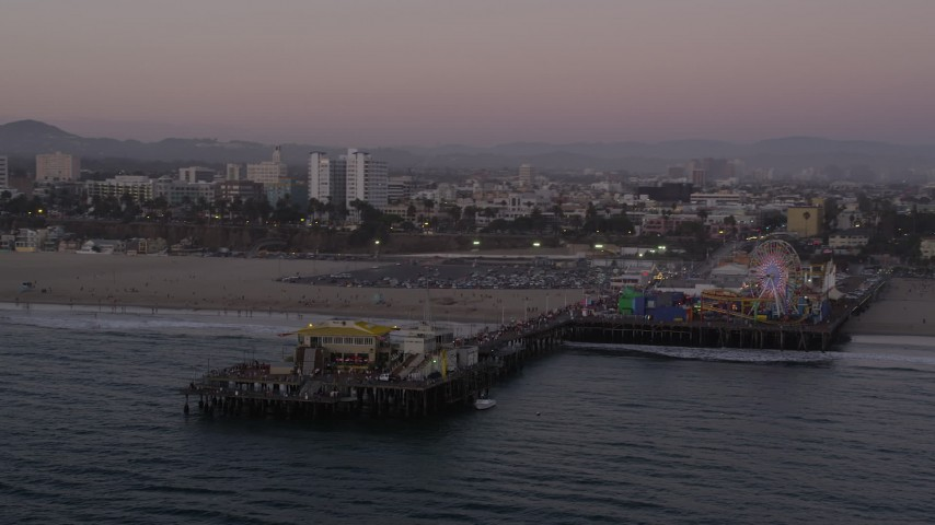 5K stock footage aerial video orbit the end of Santa Monica Pier and the Pacific Wheel at twilight, California Aerial Stock Footage | AX69_035