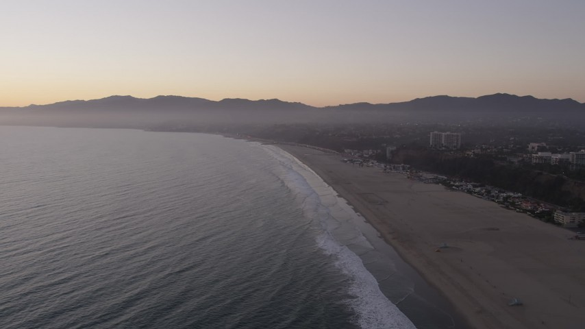 5K stock footage aerial video approach Santa Monica State Beach, deserted at twilight, California Aerial Stock Footage | AX69_037