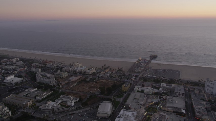 5K stock footage aerial video flyby beachside buildings and Santa Monica Pier at twilight, California Aerial Stock Footage | AX69_038