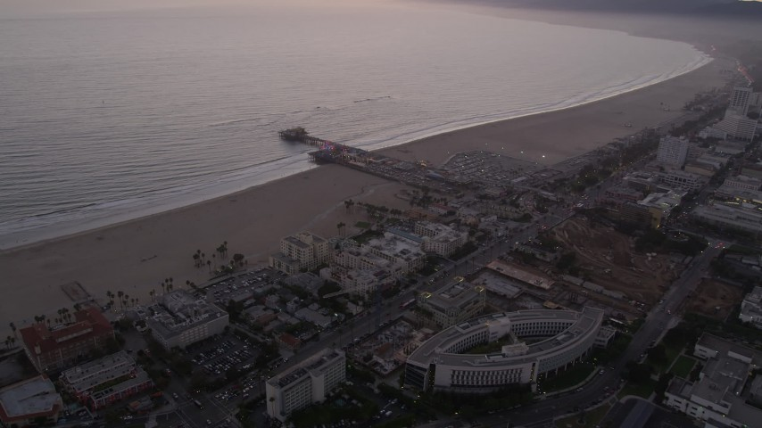 5K stock footage aerial video approach Santa Monica Pier and the beach at twilight, California Aerial Stock Footage | AX69_040