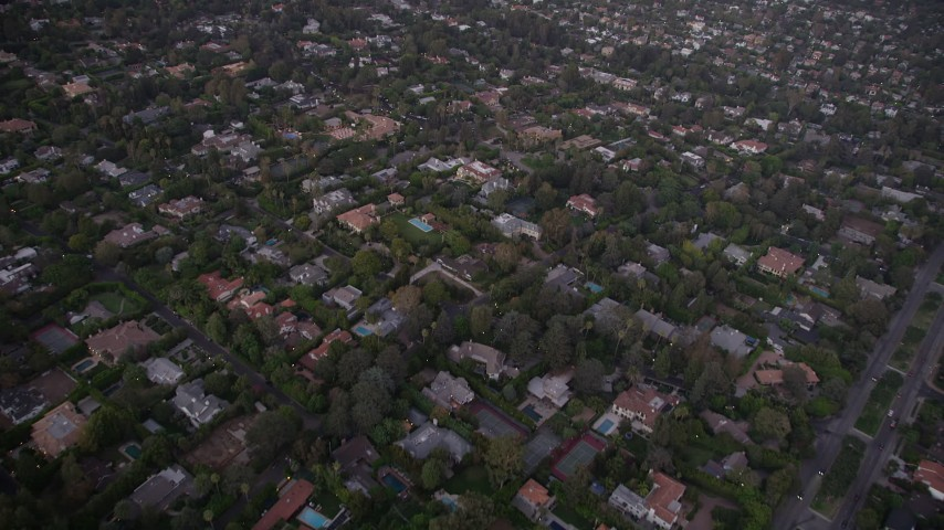 5K stock footage aerial video fly over mansions and upscale homes at twilight in Brentwood, California Aerial Stock Footage | AX69_050