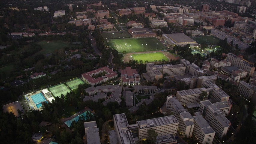 5K stock footage aerial video orbit College sports fields and campus buildings at twilight, Westwood, California Aerial Stock Footage | AX69_055