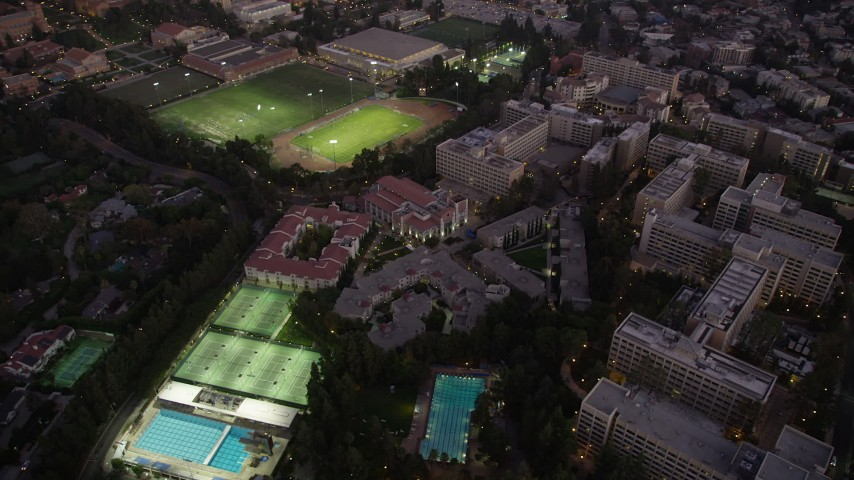 5K stock footage aerial video orbit of campus buildings and sports fields at twilight at College, Westwood, California Aerial Stock Footage | AX69_056
