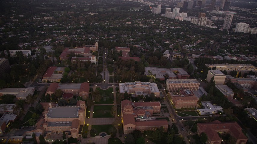 Flying over Dickson Court and buildings at the UCLA campus at twilight, Westwood, California Aerial Stock Footage | AX69_059