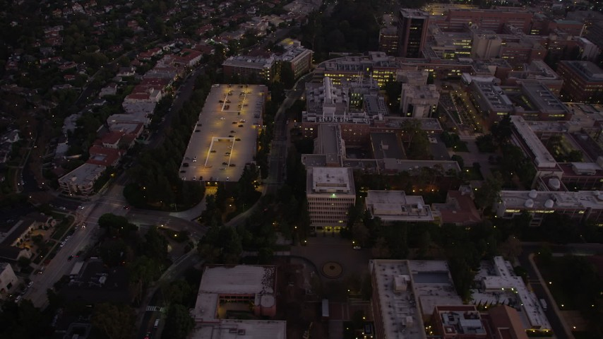 The UCLA college campus at twilight, Westwood, California Aerial Stock Footage | AX69_060