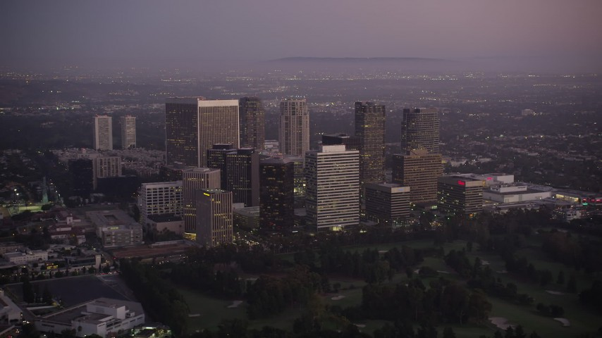 5K stock footage aerial video flyby skyscrapers in Century City at twilight, California Aerial Stock Footage | AX69_066