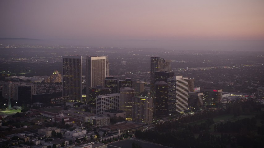 5K stock footage aerial video of Century City skyscrapers at twilight in California Aerial Stock Footage | AX69_067