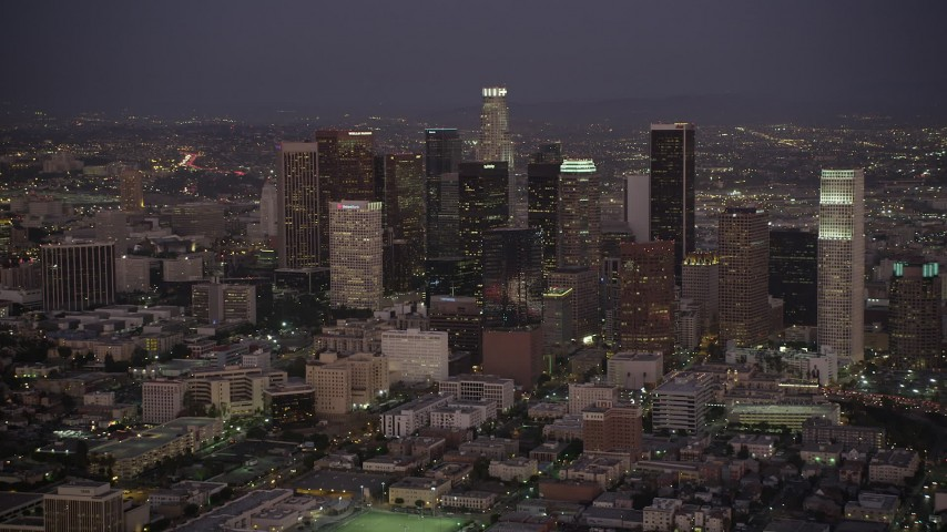 5K stock footage aerial video slow approach to Downtown Los Angeles at night, California Aerial Stock Footage | AX69_079