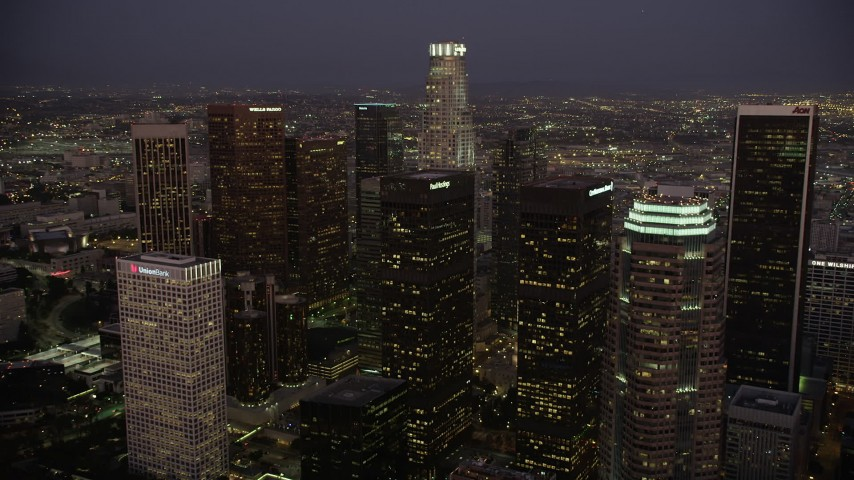 5K stock footage aerial video approach skyscrapers at night in Downtown Los Angeles, California Aerial Stock Footage | AX69_081