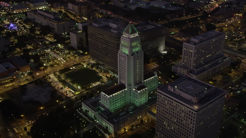5K stock footage aerial video orbit Los Angeles City Hall in Downtown Los Angeles, California at night Aerial Stock Footage | AX69_084