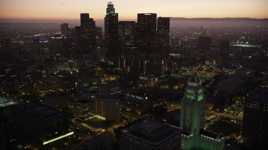 5K stock footage aerial video orbit Los Angeles City Hall and reveal skyscrapers in Downtown Los Angeles at twilight, California Aerial Stock Footage | AX69_085