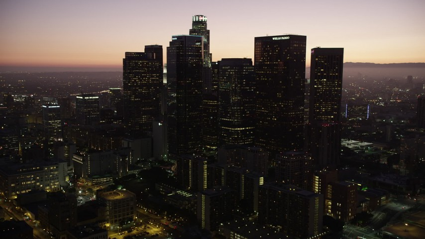 5K stock footage aerial video tilt and approach skyscrapers in Downtown Los Angeles at twilight, California Aerial Stock Footage | AX69_087