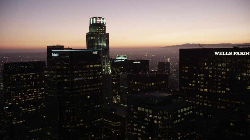 5K stock footage aerial video approach tops of high-rises in Downtown Los Angeles at twilight, California Aerial Stock Footage | AX69_088