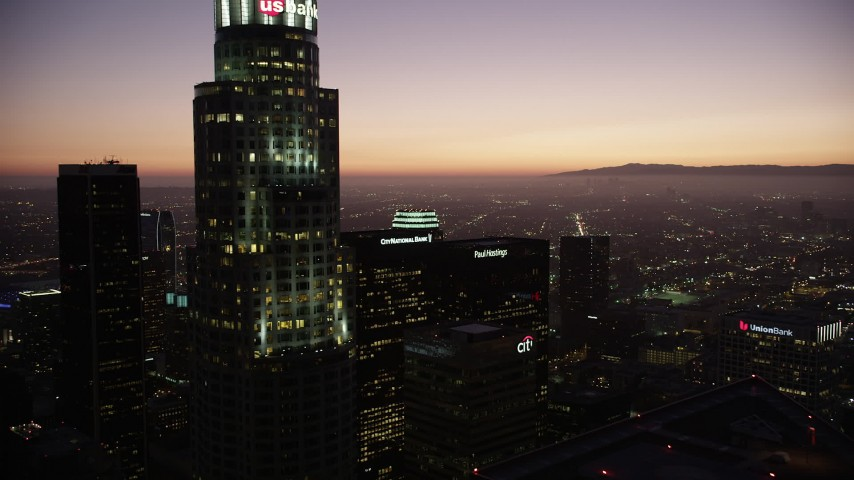 5K stock footage aerial video fly over Downtown Los Angeles and by skyscrapers at twilight, California Aerial Stock Footage | AX69_089