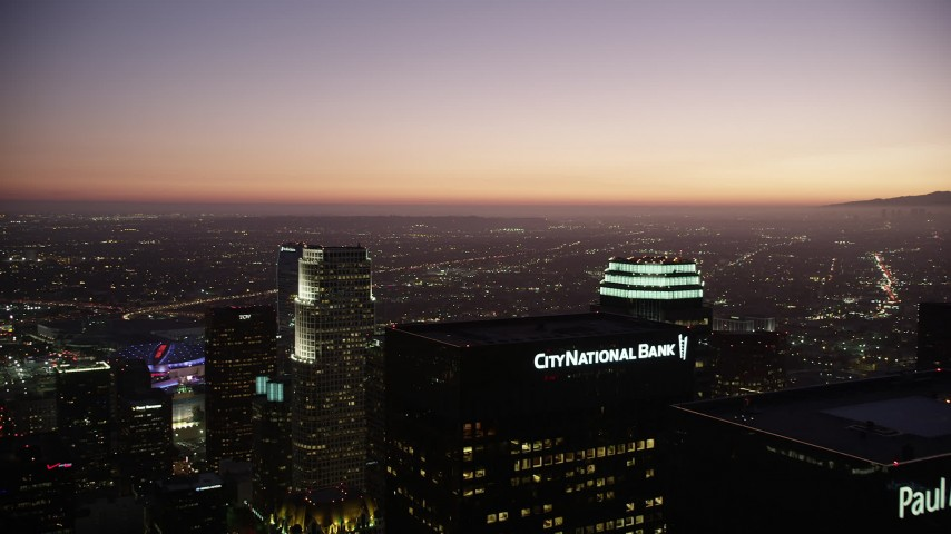 5K stock footage aerial video fly over Downtown Los Angeles skyscrapers to approach 777 Tower at twilight, California Aerial Stock Footage | AX69_090