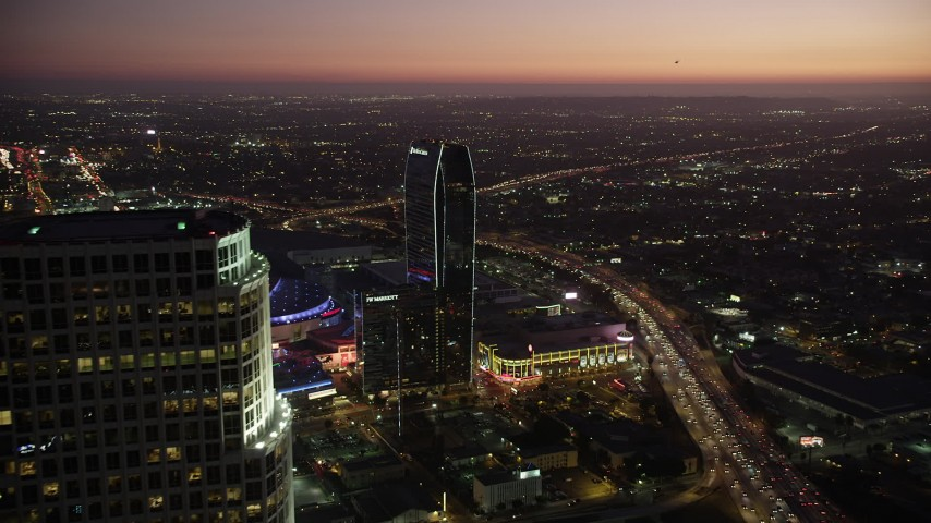 5K stock footage aerial video flyby 777 Tower to reveal The Ritz-Carlton and Staples Center in Downtown Los Angeles at twilight, California Aerial Stock Footage | AX69_091