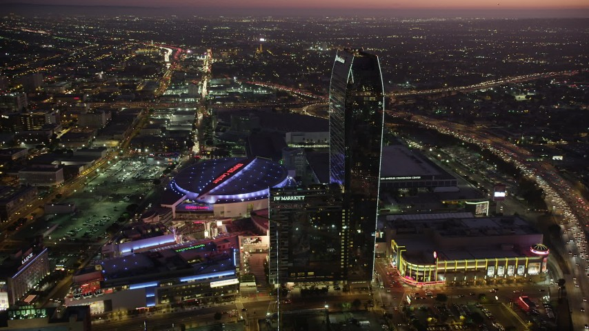 Staples Center, JW Marriott, and The Ritz-Carlton in Downtown Los Angeles, California at twilight Aerial Stock Footage | AX69_092